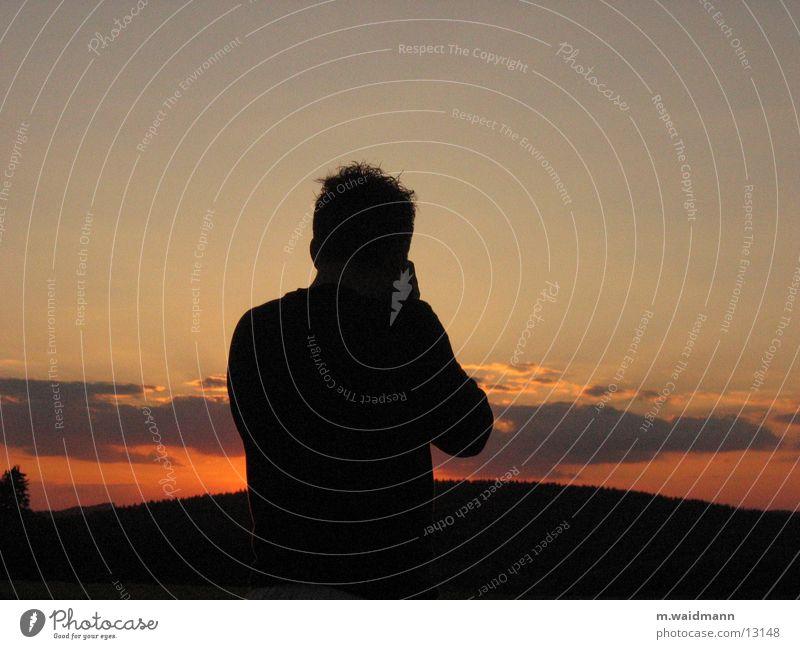 der fotograf und sein motiv Mann Sonne Wolken Berge u. Gebirge Fotokamera Fotograf