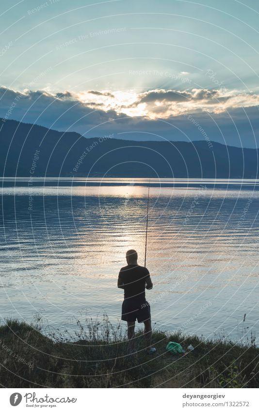 Schattenbild des Fischers Mensch Himmel Natur Ferien & Urlaub & Reisen Mann Sommer Sonne Erholung Landschaft Erwachsene Sport See Freizeit & Hobby Aktion