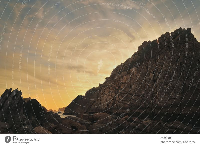 Romantik Natur Landschaft Himmel Wolken Horizont Sonnenaufgang Sonnenuntergang Wetter Schönes Wetter Felsen Küste Bucht Riff Meer Menschenleer gigantisch Wärme