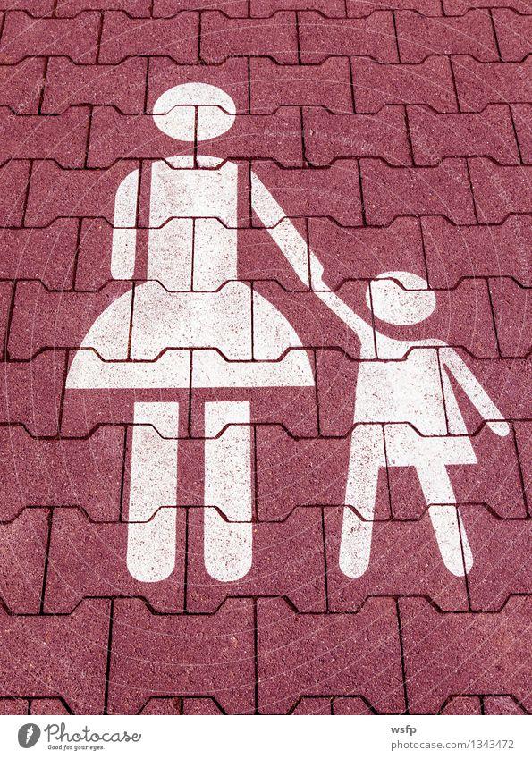 Mutter mit Kind Symbol in Rot weiß auf einem Parkplatz Kind weiß rot Erwachsene Mutter Symbole & Metaphern Asphalt Eltern Kindergarten Parkplatz parken alleinerziehend kinderfreundlich