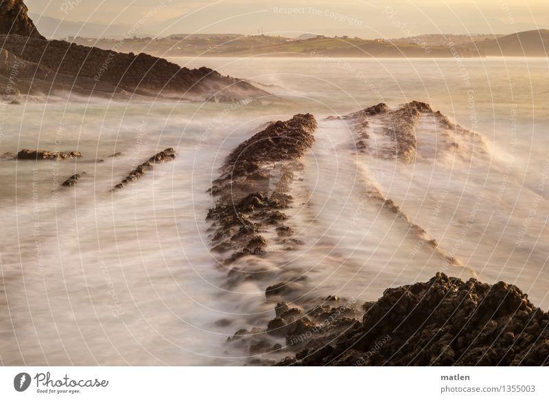 Bonbonwasser Wasser Himmel Wolken Sonnenaufgang Sonnenuntergang Felsen Berge u. Gebirge Wellen Küste Strand Riff Meer Menschenleer nass braun rosa weiß