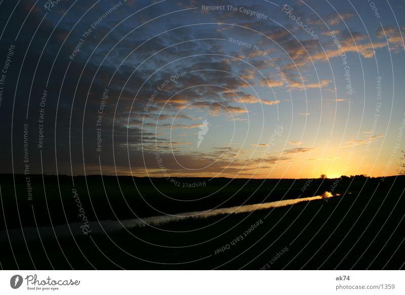 Sonnenuntergang an der Tollense Himmel Wolken Fluss Abwasserkanal