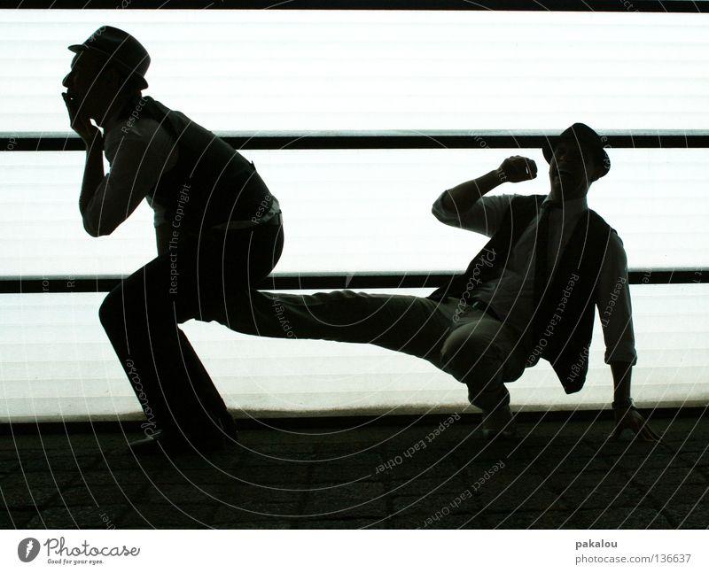reproduktion Mensch Mann Freude dunkel Beine Paar lustig 2 Zusammensein außergewöhnlich verrückt paarweise Kommunizieren Hut Schmerz Seite