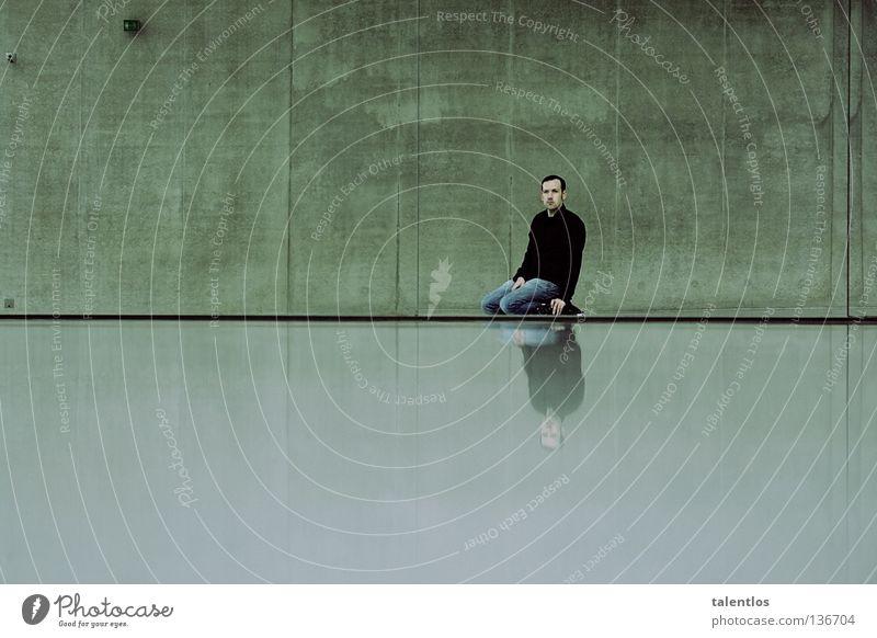 pretty lonesome Mann Einsamkeit kalt Wand grau Beton sitzen Trauer modern Jeanshose trist Spiegel Hemd Verzweiflung knien
