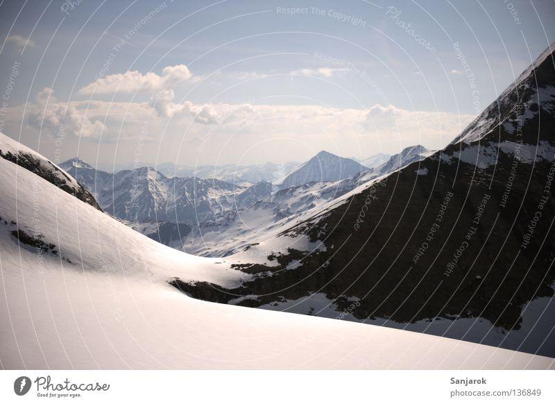 Fernweh! Winter Wolken Schnee Berge u. Gebirge Freiheit Felsen hoch Aussicht Gipfel Österreich Gletscher Blauer Himmel Berghang Durchblick Bergkette