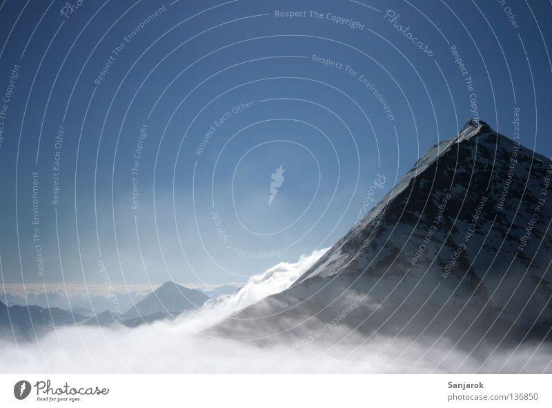 Über den Wolken III Österreich Großglockner Gipfel Winter Wetterumschwung Hochgebirge Berghang hoch Ferne Fernweh Berge u. Gebirge Schnee Felsen Blauer Himmel
