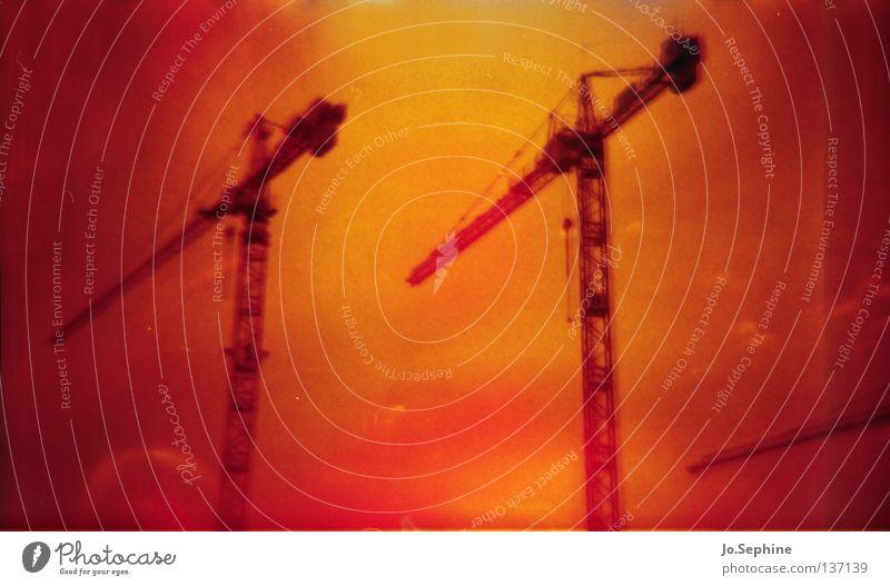 construction time, again - himmel brennt Baustelle Industrie Himmel Surrealismus Kran analog Diana+ 35mm 2 rot orange Experiment Lomografie lomography