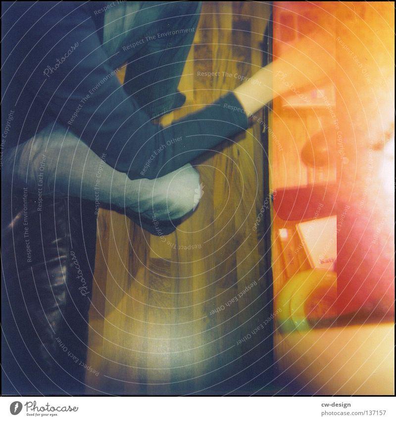 hOlGa | the drab monotony of everyday life Holga mehrfarbig Aussicht Parkett Laminat Sofa Aschenbecher Feuerzeug Papier Hand gelb schwarz Am Rand Schatten beige