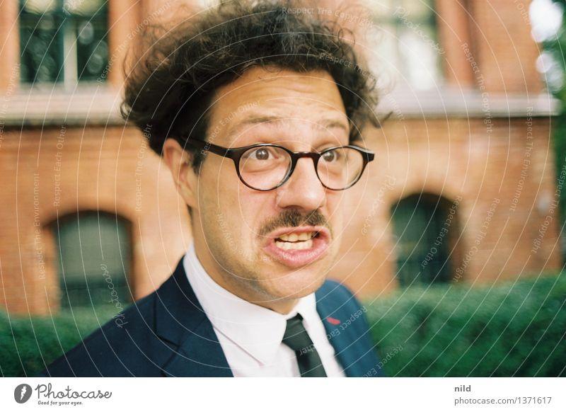 grantig Mensch maskulin Mann Erwachsene Kopf 1 18-30 Jahre Jugendliche 30-45 Jahre Mode Anzug Krawatte Brille schwarzhaarig Locken Oberlippenbart sprechen