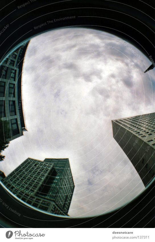 scraping the sky. (die bevölkerung des mondes.) Himmel Stadt Wolken Gebäude Architektur Hochhaus modern Leipzig aufwärts Bürogebäude schlechtes Wetter Gewitterwolken Wolkenhimmel Wolkendecke himmelwärts