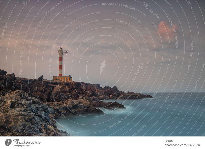 Wache Landschaft Wasser Himmel Wolken Sommer Schönes Wetter Hügel Felsen Wellen Küste Insel Teneriffa Leuchtturm alt groß schön wild weich blau braun rot weiß