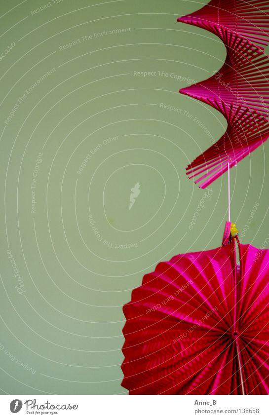 Hanging around... Design Dekoration & Verzierung Feste & Feiern Papier Kitsch Krimskrams hängen einfach trendy nah grün rosa Inspiration Laterne Spirale knallig