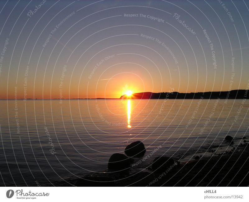 Rügener Sonnenuntergang II Sonnenstrahlen Meer Beleuchtung Abend Wasser Küste Stein Reflexion & Spiegelung