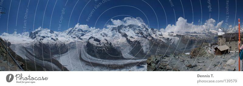 Himmel und Erde Ferien & Urlaub & Reisen Freiheit Schnee Winterurlaub Berge u. Gebirge Landschaft Schönes Wetter Eis Frost Gletscher Dorf Stein groß hoch blau