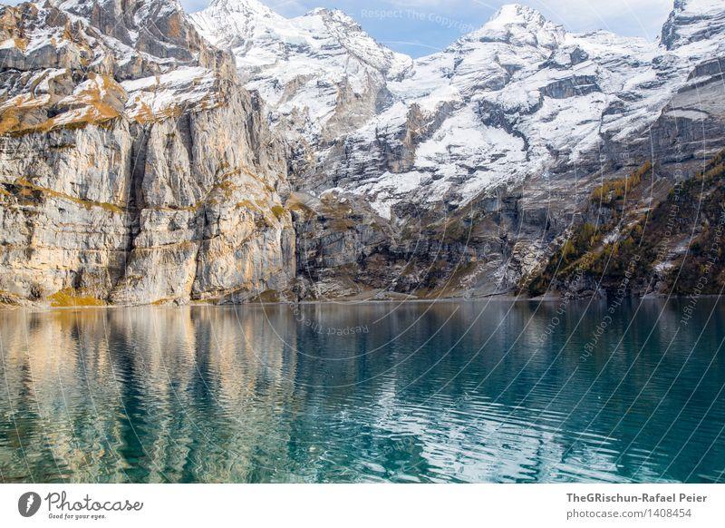 Gebirge Umwelt Natur blau braun gelb grau grün schwarz silber türkis weiß Berge u. Gebirge Wasser See Oeschinensee Schweiz Felsen Stein Schneebedeckte Gipfel
