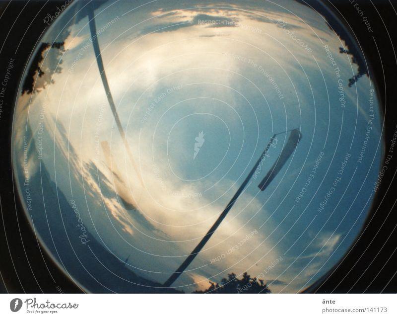 Sonnenuntergangskreis Lomografie Fischauge lomo Fischlehre sonnenuntergang doppelbelichtung Windsack wolken stimmung dynamisch verwirrt verzerren verzerrt