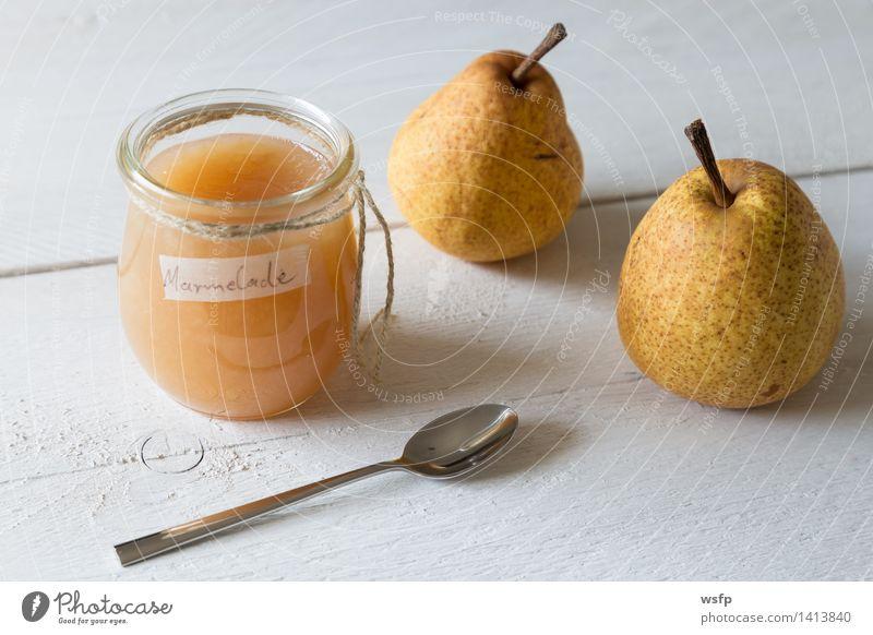 Birnenmarmelade in einem Einmachglas Frucht frisch Schnur lecker Frühstück Vitamin Vegetarische Ernährung Diät Holztisch Löffel Vegane Ernährung selbstgemacht