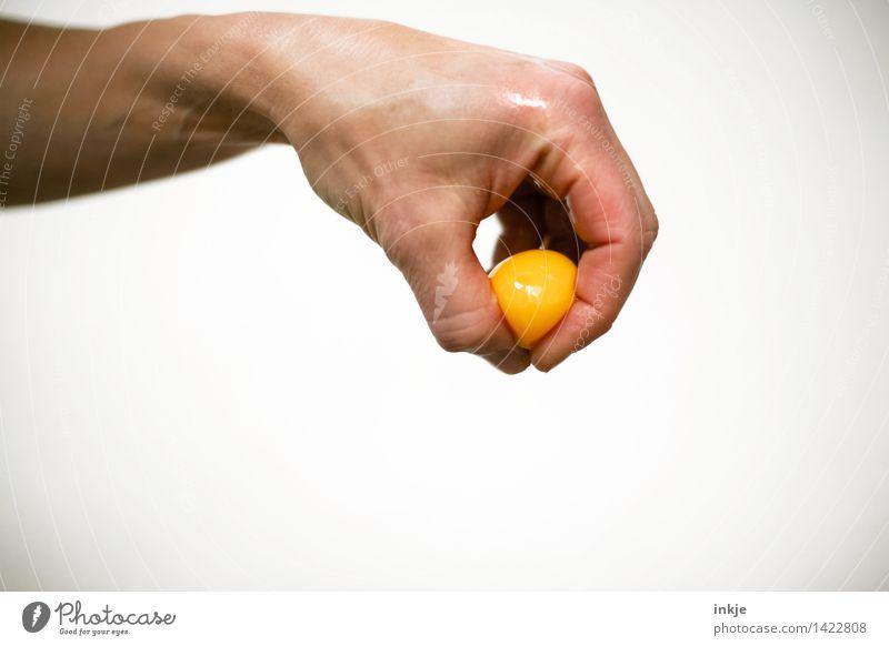 Fingerfood: Das Gelbe vom Ei. Lebensmittel Eigelb Ernährung Zutaten Freizeit & Hobby maskulin feminin Erwachsene Hand 1 Mensch festhalten Ekel nass skurril