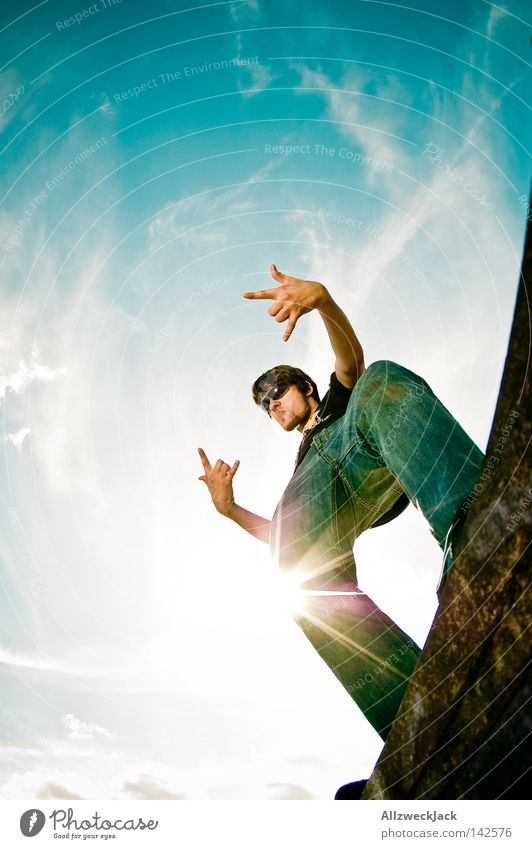 Mano Cornuto Mann Himmel Sonne Freude Wolken Jeanshose Körperhaltung Rockmusik Gegenlicht gestikulieren Potsdam Rock `n` Roll musizieren rocken