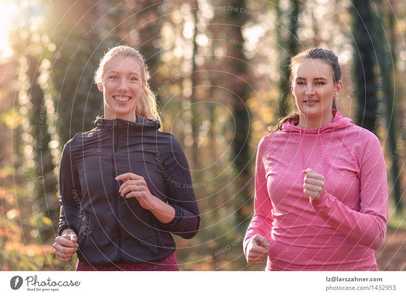 Mensch Frau Jugendliche 18-30 Jahre Wald Gesicht Erwachsene Herbst sprechen Sport Glück Lifestyle Freundschaft Lächeln Fitness Entwurf