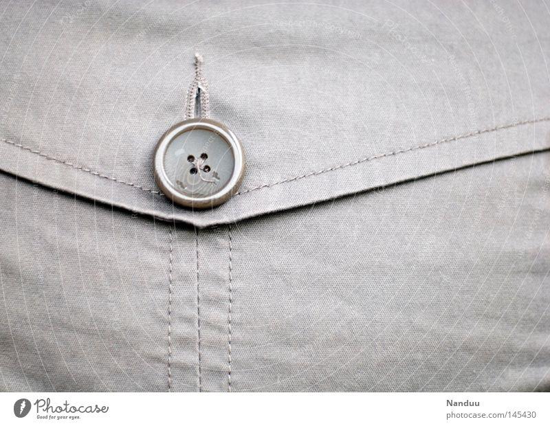 Verschlussmechanismus Knöpfe Stoff Textilien Textilindustrie Mode Jacke Mantel Tasche schließen Schneiderei grau Bekleidung heizen Stil Dinge Handwerk Lasche