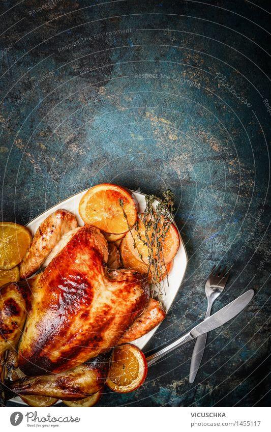 Brathähnchen auf Teller und geröstete Orangen Weihnachten & Advent dunkel Speise Foodfotografie Stil Lebensmittel Feste & Feiern Design Frucht Häusliches Leben