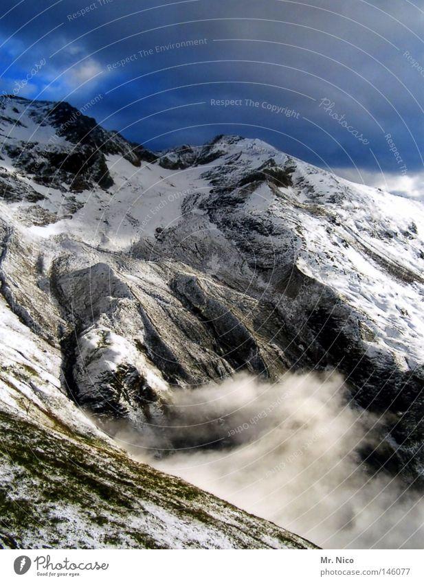 derwinterstehtvordertürfoto Natur Himmel weiß blau Pflanze Winter Ferien & Urlaub & Reisen schwarz Wolken Schnee Berge u. Gebirge grau Stein Landschaft Eis