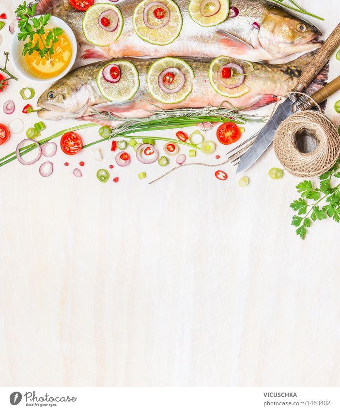 Frischer Saibling mit Zutaten für Fischgerichte Natur grün Gesunde Ernährung Leben Essen Foodfotografie Stil Hintergrundbild Lebensmittel Design frisch Tisch