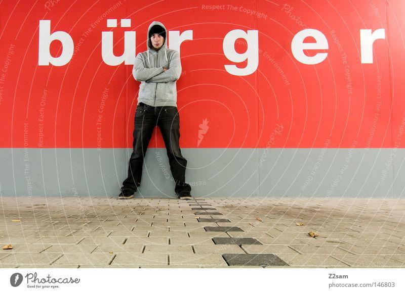 Du bist Deutschland Mensch Politik & Staat Mann Einsamkeit grau orange Arme maskulin Jeanshose stehen Buchstaben Wut Amerika Mütze tief