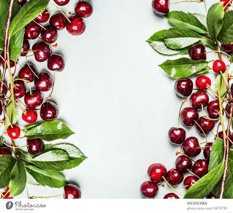 Kirschen mit Zweigen und Blättern Lebensmittel Frucht Ernährung Frühstück Stil Gesunde Ernährung Sommer Garten Tisch Natur Design Vitamin Zweige u. Äste Blatt