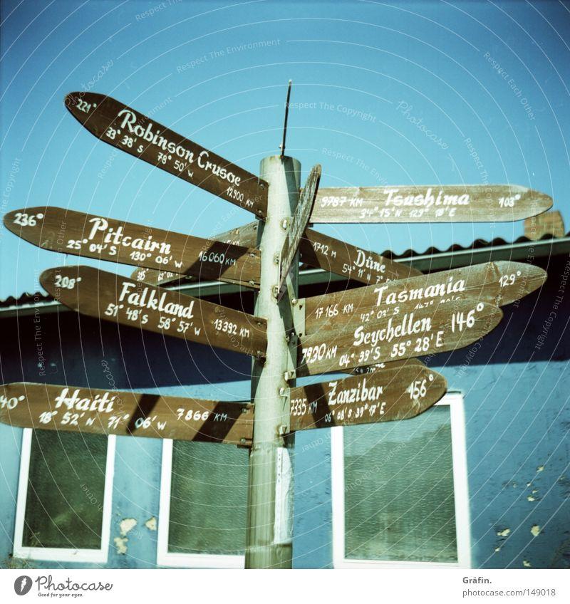 Wohin denn nun? Ferien & Urlaub & Reisen Afrika Haus Australien Schilder & Markierungen Schriftzeichen Insel Hinweisschild Schönes Wetter Buchstaben Ziel
