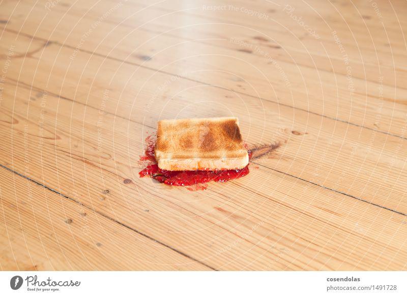Murphys Gesetz Lebensmittel Getreide Teigwaren Backwaren Brot Marmelade Ernährung Essen Frühstück Fastfood Gefühle dumm Ärger Frustration Missgeschick Farbfoto