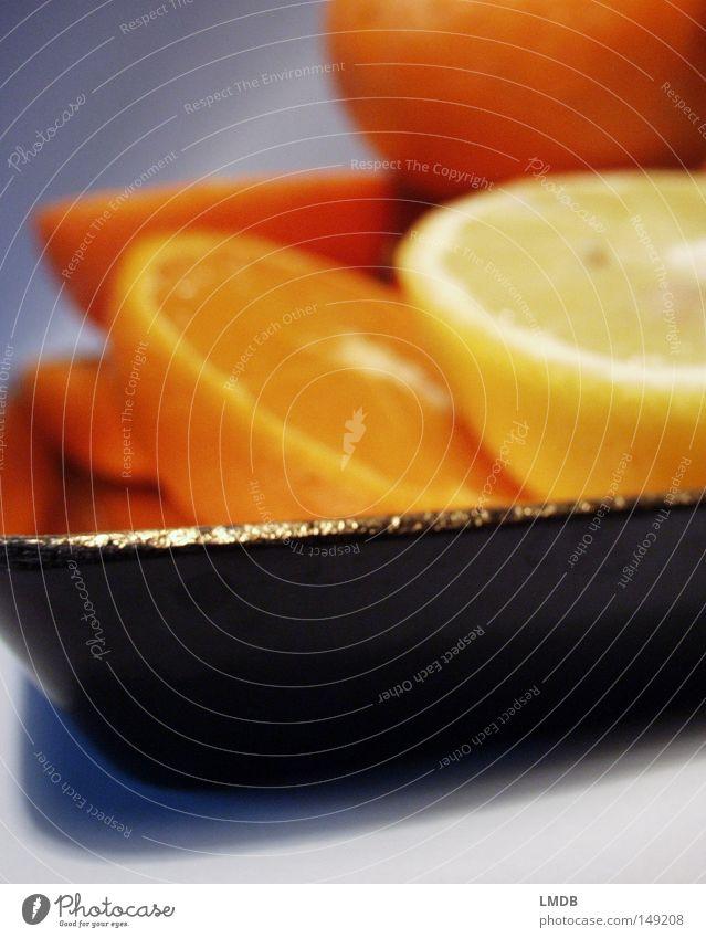 goldige Orangen Mandarine Grapefruit Zitrusfrüchte gelb Tablett Teller Unschärfe Am Rand Warme Farbe Vitamin Gesundheit Frucht Lebensmittel kredenzen Restaurant