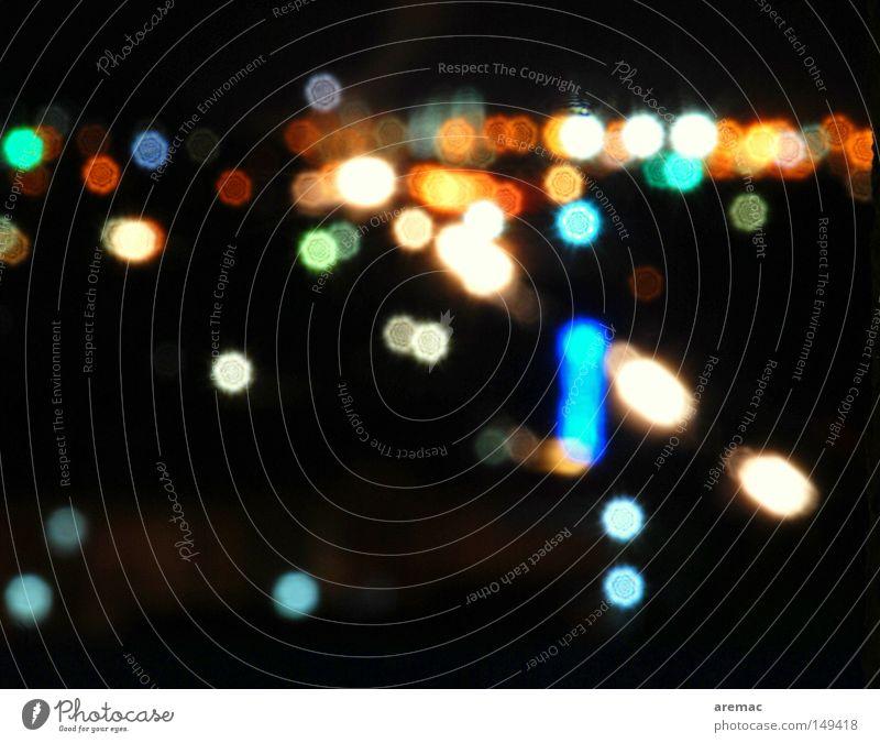 Pünktchen Licht Nacht schwarz mehrfarbig Hintergrundbild abstrakt Unschärfe Langzeitbelichtung