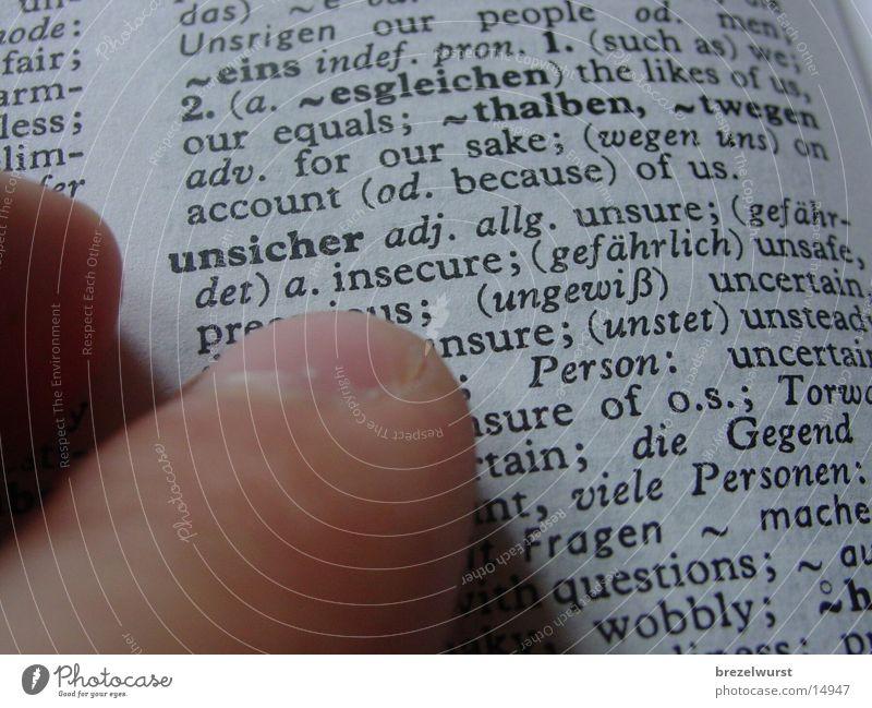 Unsicher unsicher Lexikon Buch Finger Hand Nachschlagen