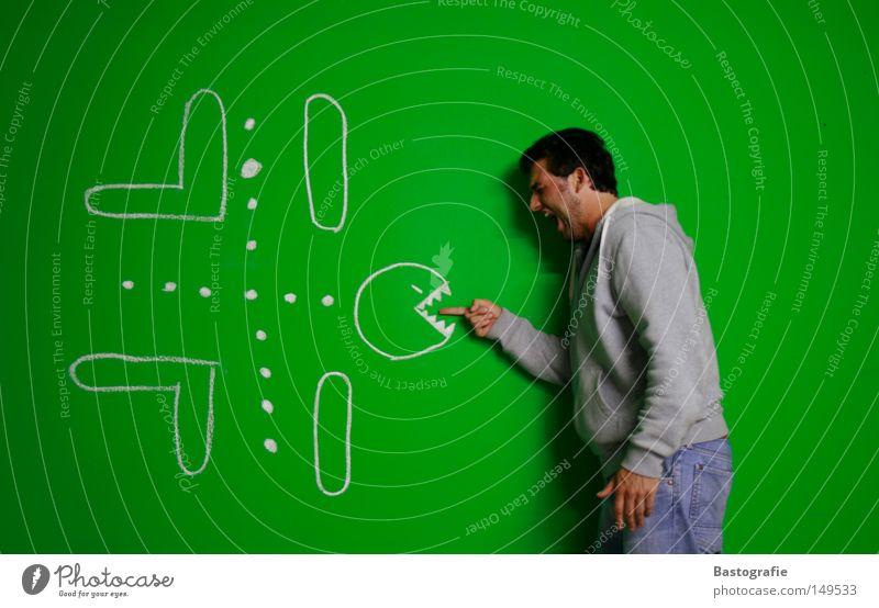 pacmans zahnarzttermin Mensch Mann Computerspiel Hand grün Freude Wand Spielen Stil grau lustig Finger Bekleidung gefährlich Gebiss bedrohlich