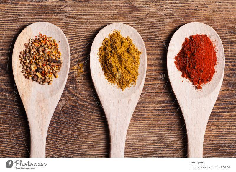 Dreierbande Lebensmittel Kräuter & Gewürze Asiatische Küche Löffel Essen gut einzigartig lecker braun gelb rot Vorfreude Curry Curcuma Chili gemahlen Kochlöffel