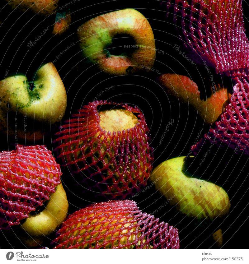 Karneval der Äpfel Frucht Netz Schutz Apfel durcheinander drücken verpackt rot-grün Obst- oder Gemüsestand