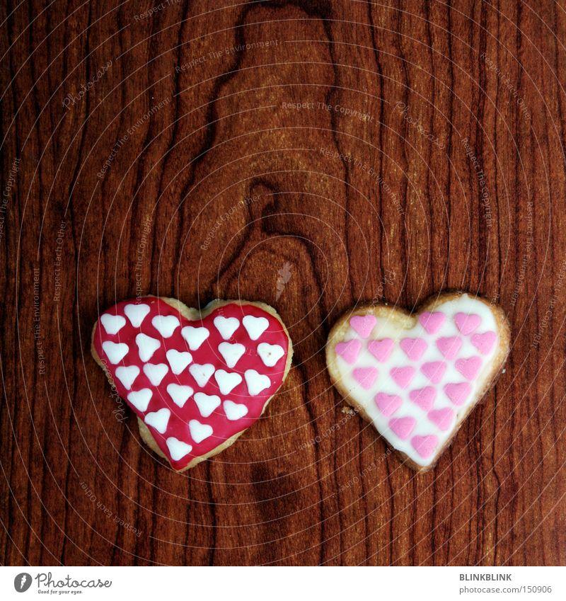 doppelherz Liebe Holz paarweise Herz süß lecker Doppelbelichtung Backwaren Zucker Valentinstag Plätzchen Maserung zusammengehörig nebeneinander knusprig Zuckerguß