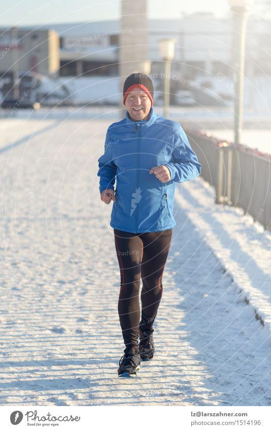 Mann, der in der Winterkleidung rüttelt Lifestyle Gesicht Schnee Sport Joggen Erwachsene 30-45 Jahre Zeitung Zeitschrift Park Straße Fitness Tatkraft Aktion
