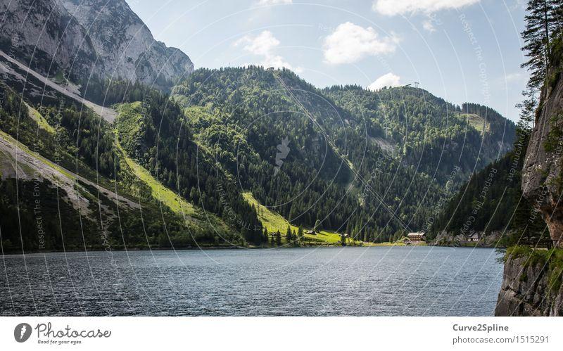 Idylle Natur Landschaft Urelemente Wasser natürlich See Seilbahn Seeufer Berge u. Gebirge Hütte Haus grün Wald Himmel Stein Wolken Hügel blau Gosausee