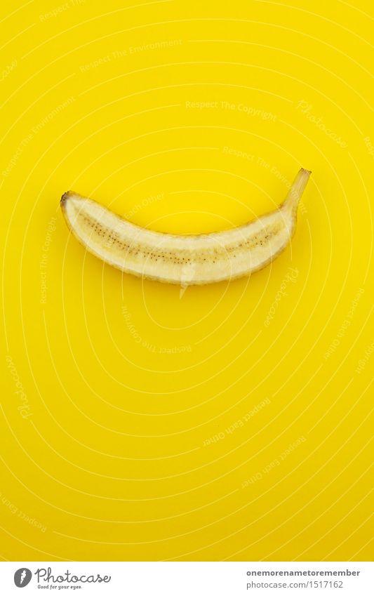 Jammy Halbbanane auf Gelb Gesunde Ernährung gelb Foodfotografie Kunst ästhetisch Kreativität Idee lecker Urwald Kunstwerk Affen Snack Banane krumm Inhalt
