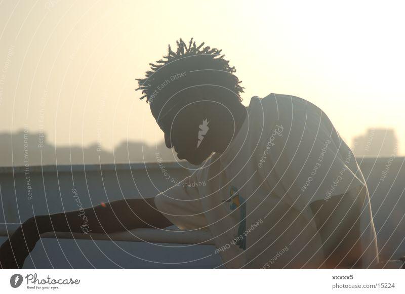 Rastaman Mann Erholung Zufriedenheit Afrika Rastalocken Abendsonne