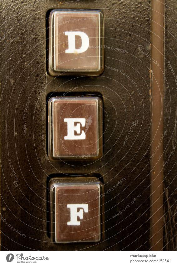 D.E.F. braun Industrie retro Schriftzeichen Buchstaben berühren Typographie Automat Gehäuse
