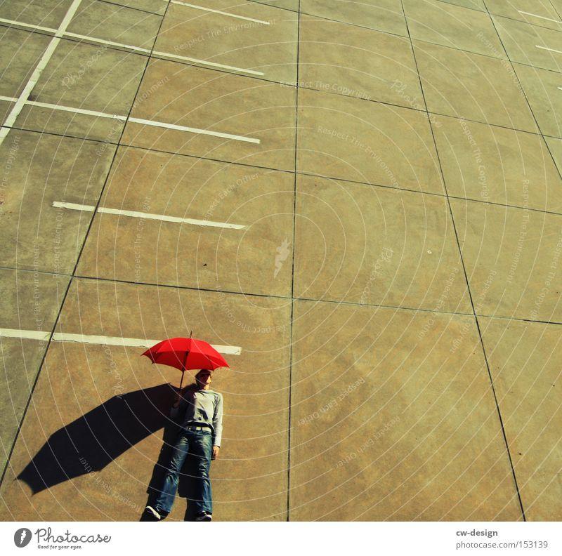 AntiVir On II Regenschirm Mensch rot Beton Vogelperspektive Parkplatz Parkdeck Schönes Wetter Schatten Mann maskulin gegen stehen liegen Kunst Kunsthandwerk