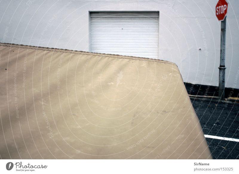 40 [street stories - abstract access] Stadt ruhig Wand Straße Mauer geschlossen Falte Afrika Surrealismus Composing Straßennamenschild Ocker Stoppschild Garagentor