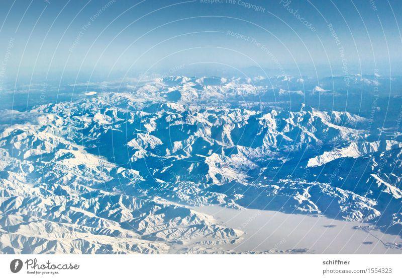 Von oben so friedlich Himmel Natur blau Landschaft Winter Berge u. Gebirge Umwelt Schnee Felsen Eis Klima Schönes Wetter Gipfel Schneebedeckte Gipfel