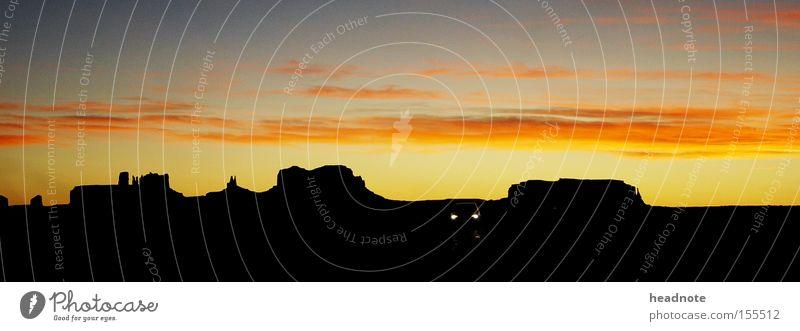 Wie Lucky Luke... Sonnenuntergang Himmel Wolken Ferien & Urlaub & Reisen Reisefotografie Silhouette unterwegs Fernweh Wohnmobil Amerika Horizont schwarz rot