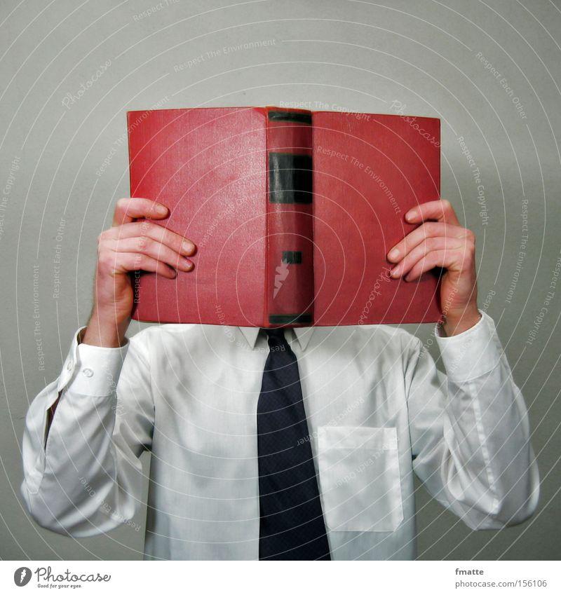 Mann mit Buch Business Studium lernen lesen Bildung verstecken Krawatte Lexikon Medien
