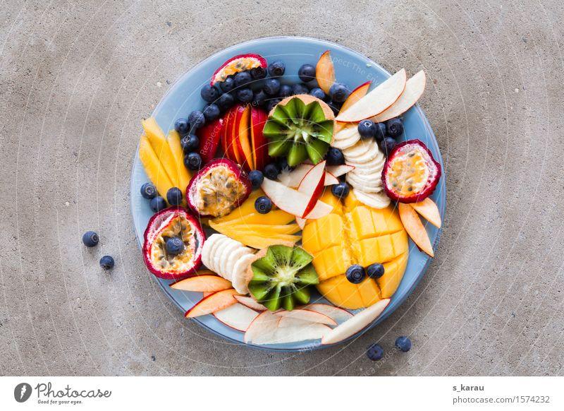 Obstteller Gesunde Ernährung Gesundheit Lebensmittel Frucht frisch genießen Beton süß Bioprodukte Apfel exotisch Teller Vegetarische Ernährung Diät Banane